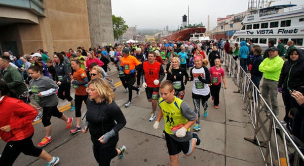 FILE - Over 2,000 runners competed in the William A. Irvin 5K race in downtown Duluth, as part of festivities leading up to Saturday's Grandmas Mara