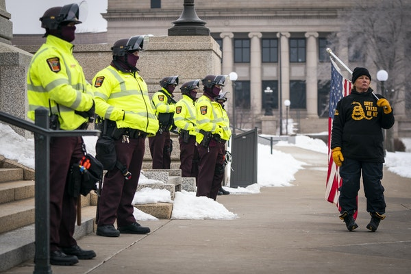 Minnesota State troopers guard the Capitol during a rally supporting President Trump at the Minnesota Capitol, Saturday, Jan. 9, 2021 in St. Paul, Min