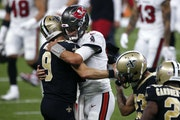 Drew Brees and Tom Brady will face off in the first playoff meeting between two quarterbacks 40 or older.