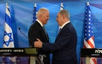U.S. Vice President Joe Biden and Israeli Prime Minister Benjamin Netanyahu shake hands while giving joint statements at the prime minister's offi