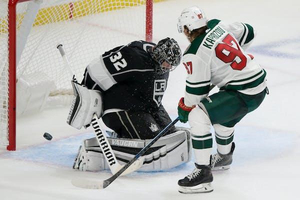 Wild left wing Kirill Kaprizov scores against Los Angeles Kings goaltender Jonathan Quick during overtime