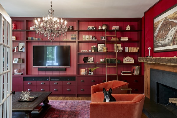 A TV room in a home in Cold Spring, N.Y., where Ammor Architecture integrated the TV into built-in shelving, adding swivel chairs that can rotate to f