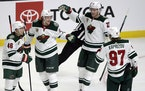 Minnesota Wild defenseman Jonas Brodin, second from left, of Sweden, celebrates with defenseman Jared Spurgeon, left, center Nick Bjugstad, second fro