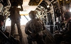 Members of the American military in a helicopter over Helmand province, Afghanistan, Sept. 26, 2019.