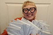 """KT Taylor held copies of the zine, """"Not Alone, Never Was: a Penpal Zine 4 Rural Queers."""""""