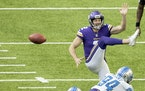 Austin Bryant (94) of the Detroit Lions blocked a punt by Minnesota Vikings Britton Colquitt (2) in the third quarter.