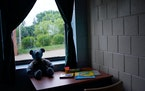 A teddy bear sat along with art supplies against a defaced window in one of the bedrooms at St. Joseph's Home for Children. ] ANTHONY SOUFFLE • an