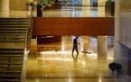 A janitor sweeps the floor in the massive Gonda Building.   Mayo Clinic employs over 59,000 people, 33,000 at its Rochester, MN location and system-wi