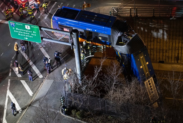 Bus dangles from overpass in NYC