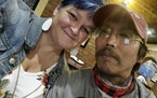 In this Sunday, Oct. 4, 2020, photo, Debra Ferrell and her husband, Jun-Jun, take a photo together on her 53rd birthday in Roanoke, Va. Ferrell's fa