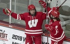 Wisconsin's Britta Curl (17) celebrated with teammates after a scoring a goal vs. Minnesota in 2019.
