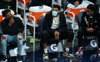 Timberwolves center Karl-Anthony Towns, out with a wrist injury, watched from the bench during a game earlier this month.