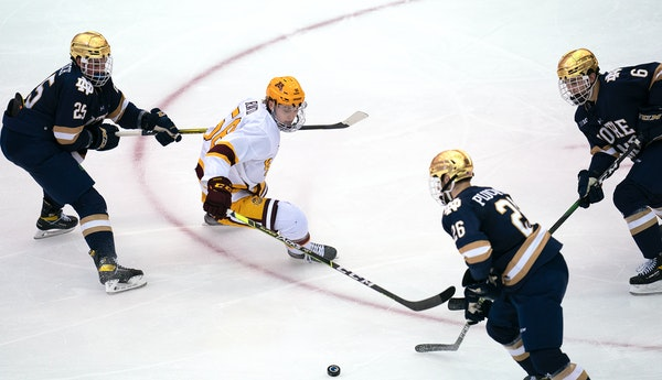 Gophers forward Sampo Ranta battled Notre Dame's Solag Bakich (25), Zach Plucinski (26) and Jake Boltman during the second period.