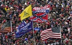 Supporters holding Confederate-themed and other flags at the Jan. 6 rally in Washington that preceded an attack on the U.S. Capitol.
