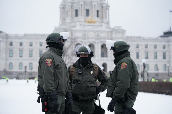 An estimated 100 state troopers flanked the sidewalks and stood on the State Capitol steps while rallygoers gathered in St. Paul on Saturday.
