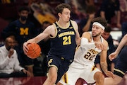 Michigan guard Franz Wagner drove to the basket as Minnesota guard Gabe Kalscheur defended in the second half.