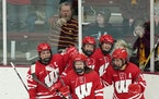 Wisconsin forward Daryl Watts (19) celebrated with teammates after she scored a goal at Ridder Arena in 2019 vs. the Gophers.