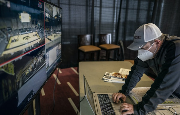 Play-by-play man Mike Grimm used four remote video feeds — some less fuzzy than others — in a room at TCF Bank Stadium to call last Sunday's Gop