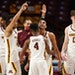 Gophers guards Tre' Williams (1) and Jamal Mashburn Jr. (4) celebrated after beating Michigan on Saturday.