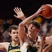 Gophers center Liam Robbins drove to the basket between Michigan defenders on Saturday.