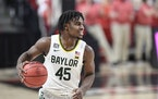 Baylor's Davion Mitchell controls the ball during the second half against Texas Tech