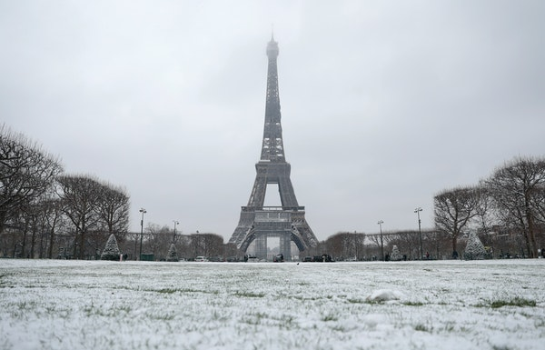 Snow dusts Paris landmarks as cold spell hits
