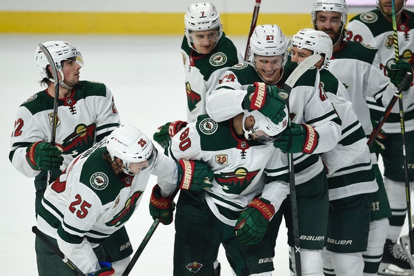 Wild players congratulate Marcus Johansson, front center, on his overtime goal against the Los Angeles Kings