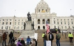 AARON LAVINSKY • STAR TRIBUNE An estimated 100 troopers flanked the sidewalks and stood on the State Capitol steps while rallygoers gathered in St.