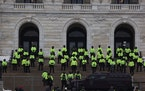 A large security presence was visible Sunday morning at the Minnesota State Capitol. A warning from authorities remained in effect Sunday for people t