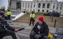Robert Marvin, a Trump supporter, peacefully protested Sunday on the steps of the Minnesota State Capitol. There was heavy security at the State Capit