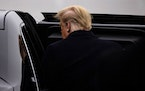 President Donald Trump gets into the presidential limousine after landing at New York Stewart International Airport in New Windsor, N.Y., Dec. 12, 2