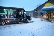 Josh Phillips and his daughter Laree, 1, exit the Prime service from SouthWest Transit bus curbside to Laree's daycareTuesday, Jan. 10, 2016,  in Ed