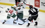 Wild goalie Cam Talbot snared a shot during Thursday's victory in Los Angeles.