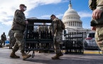 National Guard members unload weapons and supplies outside of the U.S. Capitol building on Sunday, Jan. 17, 2021 in Washington, D.C. After last week