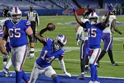 Buffalo Bills wide receiver Stefon Diggs (14) celebrates after scoring a touchdown during the second half against Baltimore.