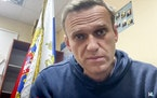 In this image taken from video released by Navalny Life youtube channel, Russian opposition leader Alexei Navalny speaks as he waits for a court heari