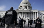 High level security officials make a survey of the East Front of the Capitol after an announcement of security problems during a rehearsal for the 59t
