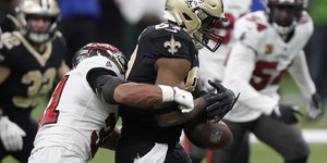 New Orleans Saints tight end Jared Cook, center, fumbles the ball as he is hit by Tampa Bay Buccaneers strong safety Antoine Winfield Jr. during the s
