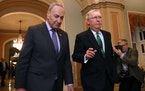 Left, Senate Minority Leader Charles Schumer, D-N.Y., and Senate Majority Leader Mitch McConnell, R-Ky., walk to the Senate Chamber.