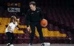 Gophers basketball coach Richard Pitino played one-on-one with his daughter, Ava, before the start of a team scrimmage in 2018.