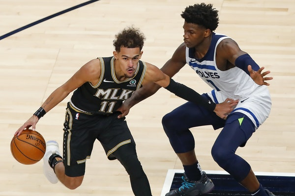 Atlanta Hawks guard Trae Young (11) battles Minnesota Timberwolves guard Anthony Edwards (1) in the second half of an NBA basketball game on Monday, J