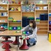 Kindergarten teacher Kate Boynton scrubbed the desks in her classroom last week at Oxbow Creek Elementary in Champlin.