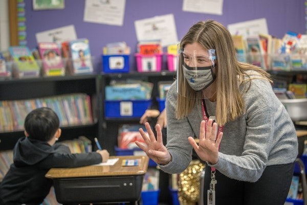Poplar Bridge Elementary School second-grade teacher Nicole Blons worked with her class during the first day of full in-person instruction Tuesday in