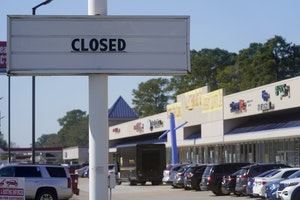 The closed sign of a former restaurant is displayed at a shopping center Wednesday, Jan. 13, 2021, in Houston, Texas.