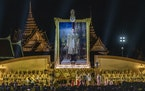 Thailand's king and queen preside over a ceremony in Bangkok on Dec. 5, 2020, commemorating the late King Bhumibol Adulyadej's birthday.
