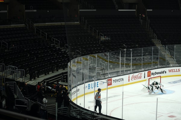 Wild goalie Cam Talbot makes a save during the third period of the team's game against the Los Angeles Kings in an empty Staples Center.
