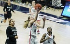 Connecticut guard Paige Bueckers drives to the basket against Butler in the second half