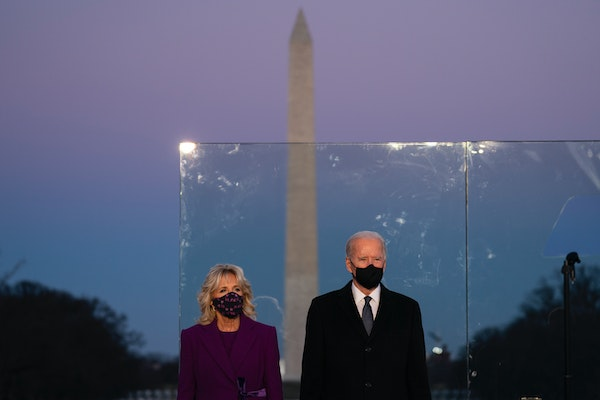 President-elect Joe Biden and his wife, Jill Biden, participate in a COVID-19 memorial event Tuesday night at the Lincoln Memorial Reflecting Pool.