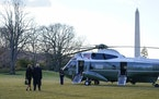 President Donald Trump and first lady Melania Trump walk to board Marine One on the South Lawn of the White House this morning in Washington. Trump is