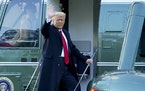 Former President Donald Trump waves good-bye Wednesday as he boarded Marine One on the South Lawn of the White House.